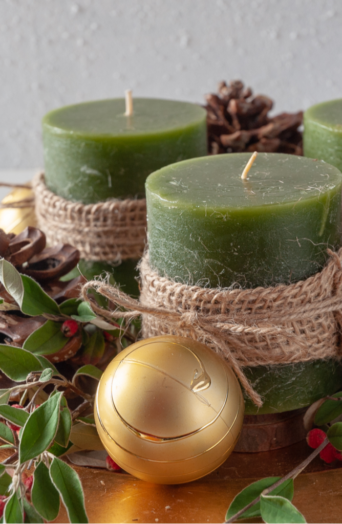 Aren't these candles so cute? All you have to do is wrap them with burlap and secure them with twine! From centerpieces to decorations, we've got the skinny on some festive dollar store holiday decorating ideas.