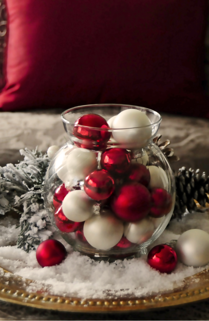 Isn't this DIY Christmas centerpiece just so cute? From centerpieces to decorations, we've got the skinny on some festive dollar store holiday decorating ideas.