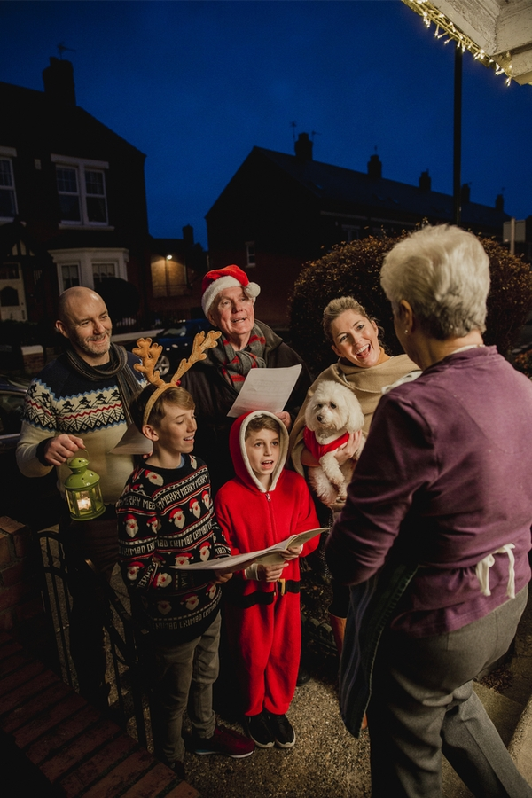 Caroling is one of the best family holiday ideas around. For more festive family holiday ideas, read here.