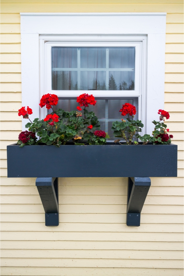 Love farmhouse style craze? Give your home a boost of extra farmhouse curb appeal with surprisingly easy farmhouse window flower boxes DIY projects. They will completely change the look of your home's exterior.