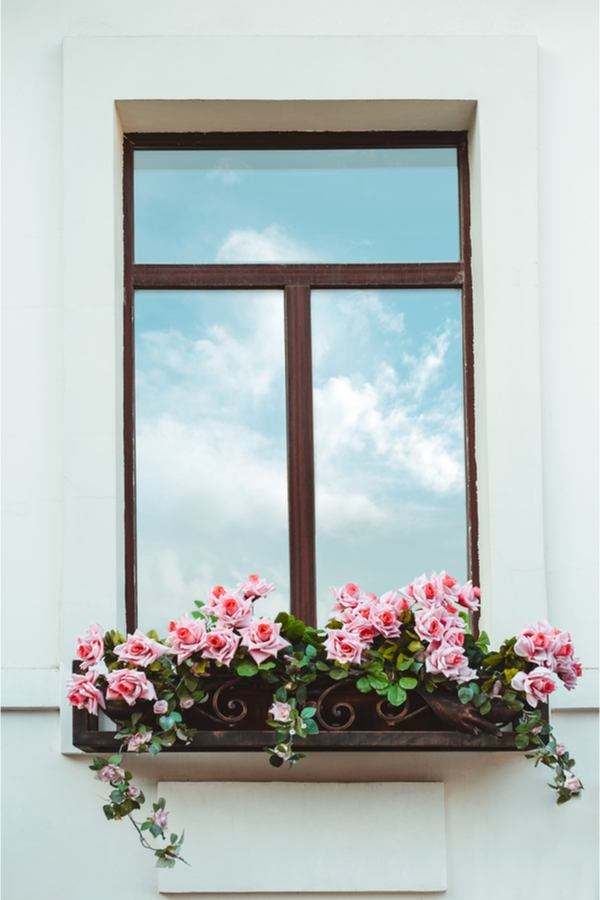 Love farmhouse style craze? Give your home a boost of extra farmhouse curb appeal with surprisingly easy farmhouse window flower boxes DIY projects. You will love the difference they make on your home.