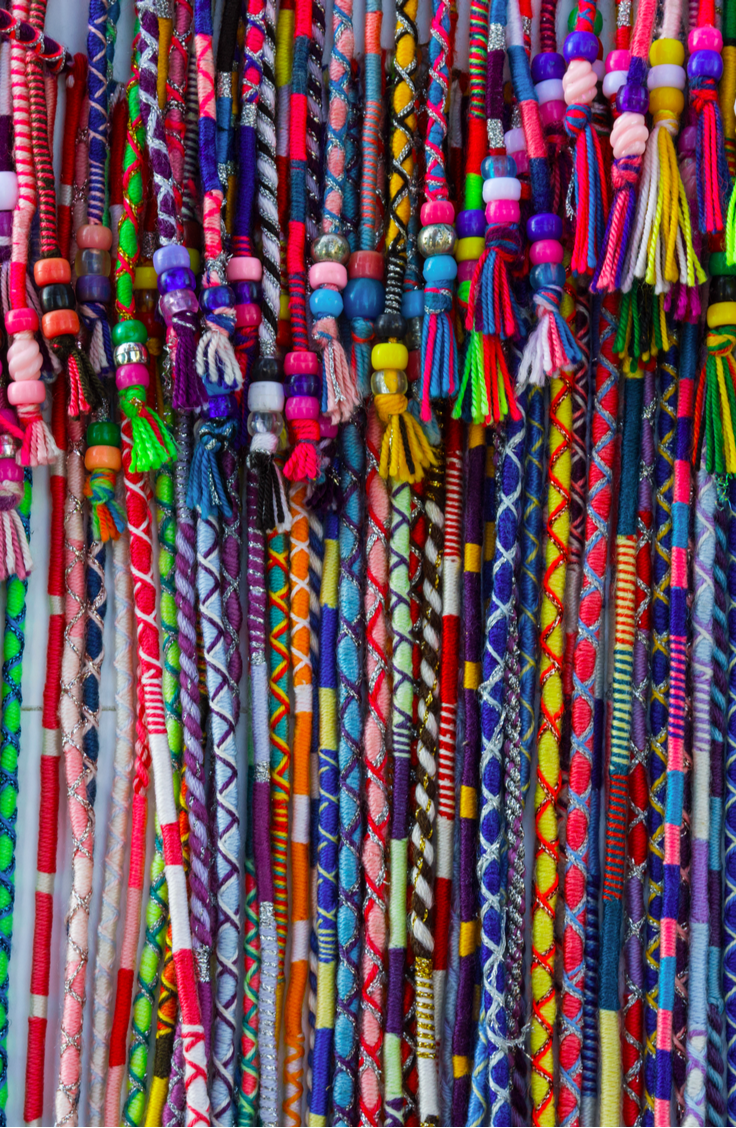 Remember hair wraps? I don't mean using a scarf to craft an updo. I mean boho-summer-chic hair wraps from those summer vacations you went on as a teenager. The ones where you wrap thread around a lock of hair in varying patterns and colors to create a look that's unique to you. It's time for them to make a comeback! Take a look at this awesome hair wrap tutorial!