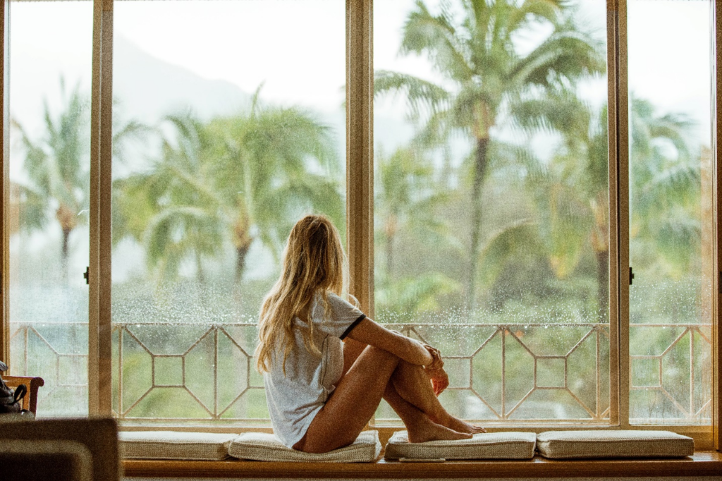 A woman sitting on a DIY window seat