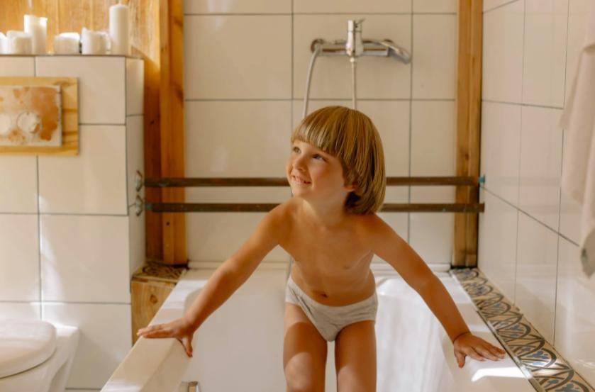 Cover the overflow drain hole with a caulk strip - make a bathtub deeper